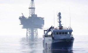 Fishing vessel and oil production platform, North Sea